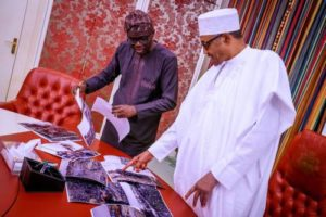 Read more about the article After Buhari Failed To Visit Site Of Lagos Explosion, Governor Sanwo-Olu Takes Photographs Of Tragedy To President In Abuja